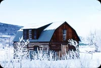 Winter email stationery. Log House Covered In Snow